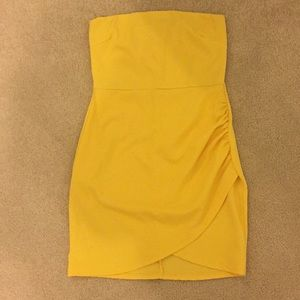 yellow strapless fitted dress